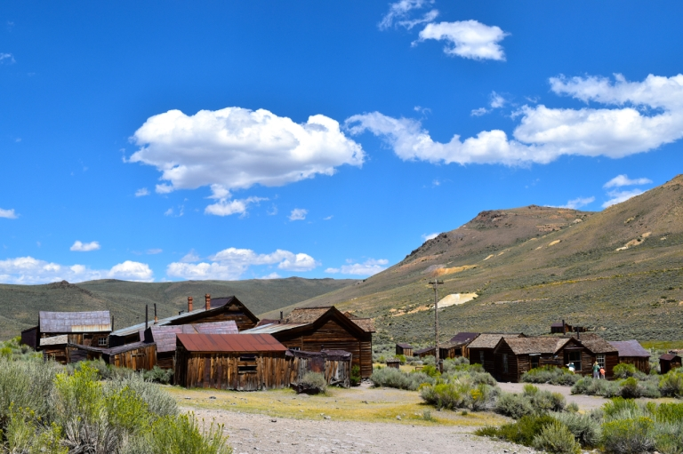 Bodie CA houses and blue sky.